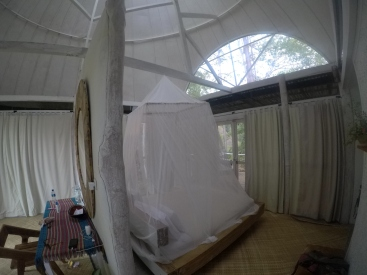 The bedroom and much needed mosquito net at the Manulalu Jungle Resort
