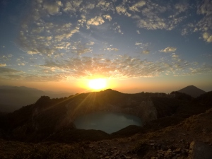 One of the crater lakes in Kelimutu National Park with the sunrise sky above