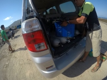 a car with its boot open showing oxygen tanks