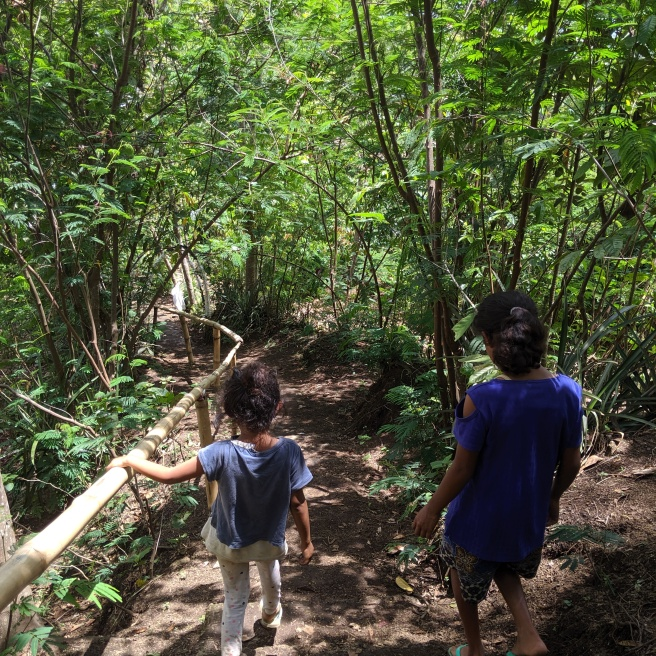 Two young girls leading the way along the path from the paddy fields view point.