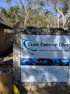 a signpost welcoming people to Blue Corner Dive